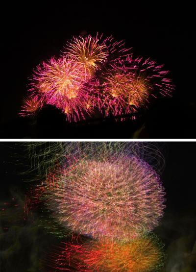 あっという間にカメラを取り上げられた、孫の淀川花火