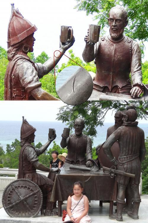 【血盟記念碑(Blood Compact Marker)】 <br />フィリピンを統治し、ボホール島にも寄航したスペイン艦隊は、1565年3月16日にスペインの『初代総督レガスピ』とボホールの『首長シカツナ』との間で友好を誓い合うことになります。その記念碑です。<br />スペインによる支配を友好的に受け入れたわけです。<br />(そうしないと無駄に血を流すことになりますから。)<br /><br />その『血盟』というのが、腕をナイフで傷つけ双方の血液をワインに入れ飲み交わすという方法で、記念碑の腕にもその傷が再現されています。<br />(かわりにここで血を流すわけですね。)<br />野蛮ですね〜 血液から病気が感染しそう。<br /><br />記念碑はボホール島出身の芸術家でナポレオン・アブエバにより建立されました。<br />