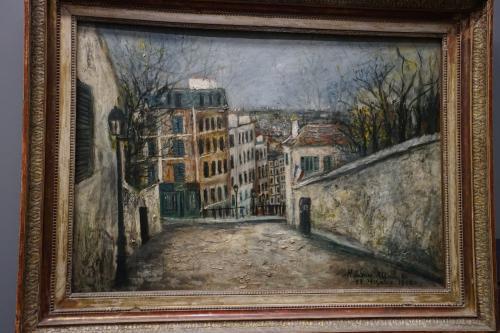 モーリス・ユトリロ「モン・スニ通り」1914年<br />モン・スニ通りというのはサン・ピエール教会前から北へ向かう通りのこと。<br />ユトリロはこの通りが見える場所に下宿していたことがあったそうです。