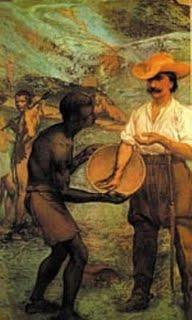 ミーナス・ジェライス州では金鉱採掘人のことを Bandeirantes(バンデイランチス)と呼んでいる。実際の重労働はアフリカから連れて来た黒人奴隷がこれに当った。(Museu Paulista de Sao Paulo:パウリスタ博物館)<br />パウリスタ博物館は各州探検者の群像や歴史的遺物・古代地図や古文書・銃・古銭・先住民に関する資料が豊富である。
