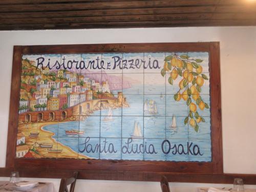 ナポリを思い出しながらの美味しいランチ<br /><br />僕たちはもうすぐブラジルに帰るよ、と社長に言うと<br />「いいな、いいな、僕は6年間イタリアに帰ってないよ」と<br /><br />来年まで帰らないことを伝えると<br />「もう完全にブラジレイロやな、いいないいな、ブラジルに行きたい」<br /><br />外国とか日本とかの垣根も無くなってしまった<br /> 温かい人たちに囲まれるか?、ってことやね<br /><br />ブラジルに帰ったら姪っ子・甥っ子と遊び倒さないとね<br /> アミーゴとオウロプレットに商談に行くのも楽しみ<br /><br />沢山の楽しみの中にアミーゴ、最高やね<br /> サンタルチアの社長もアミーゴ<br /><br />