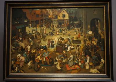 ピーテル・ブリューゲル(父)「謝肉祭と四旬節の喧嘩」1559年<br />教会と商店に囲まれた広場の情景の中に、主の公現の祝日から復活祭までの間の時期の行事や風習がちりばめられた作品。