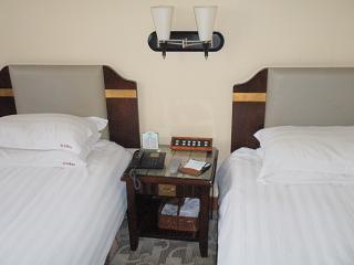 豪華客室のベッド
