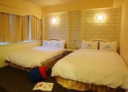 タイタン トラベラー ホテル 写真