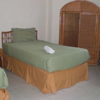 Farol Htel客室です。籐製品の家具も変わりありません