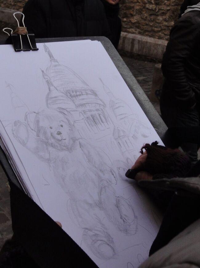 11年前の初めてのパリ、街歩きの模様をアップ!<br /><br />サクレクレール寺院の見学を終了、テルトル広場への移動の途中で記念に一枚描いてもらいました。