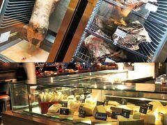 生ハム……と言うにはビジュアル的に生々し過ぎる冷蔵庫や、試食も楽しめるチーズがたくさん納められたカウンターを横目に見て。