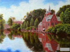 こちらはベルギーの古都、ブリュージュ。  愛の泉公園というシャレた名前の公園内の湖畔に孤高の姿を見せる教会。  無風の湖面に赤と緑のコントラストが映えます。