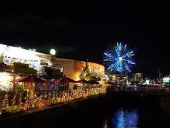 川沿いのアメリカンデポのショップと観覧車 飲食店には地元の外国の方もいっぱい。